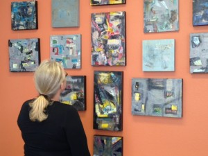 Cecilia looking at her work on the wall at Studio PAUSE